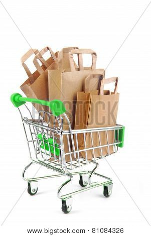 trolley with paper bags isolated