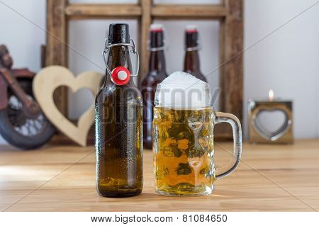 Glass Tankard Of Chilled Beer With A Bottle