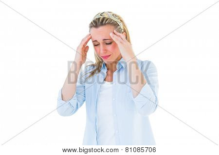 Pretty blonde grimacing and getting a headache on white background