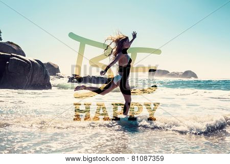Beautiful smiling woman in white bikini skipping on the beach against be happy