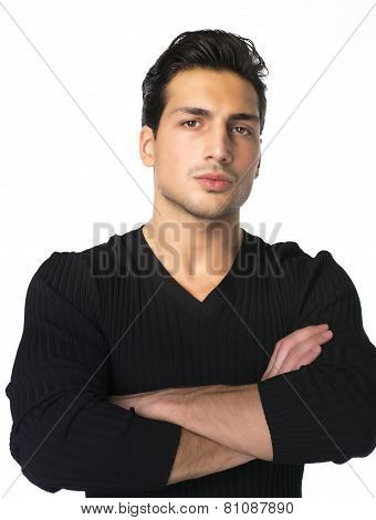 Brown Eyed, Black Haired Latin Man Standing  With Arms Crossed