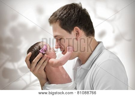 Young father is holding his newborn baby girl
