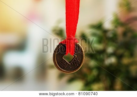 Feng shui coin on light background