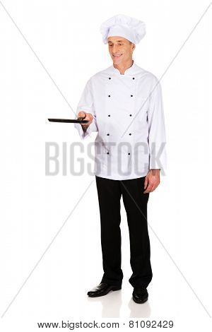 Experienced restaurant chef with frying pan
