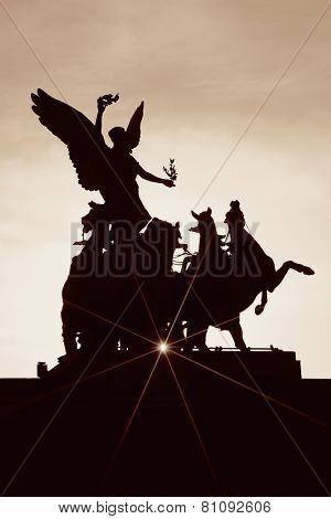 Statue silhouette with sunray in London.