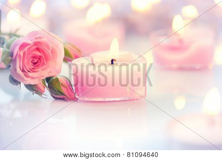Valentine's Day. Valentine Gift. Pink Heart shaped candles and rose flowers on white wooden background. Beautiful Valentine card art design