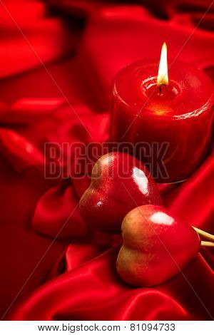 Valentine's Day. Valentine Red Hearts and candle on Red Silk Background. Beautiful Valentine card art design