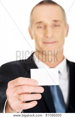 Businessman showing a blank identity name card.