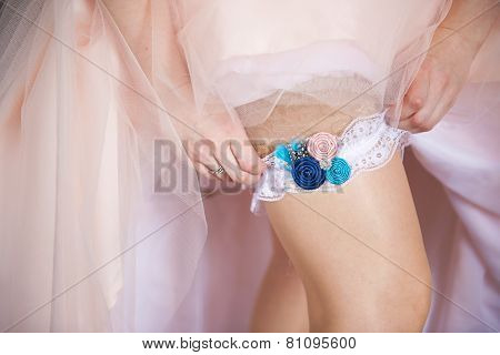 Young bride getting dressed