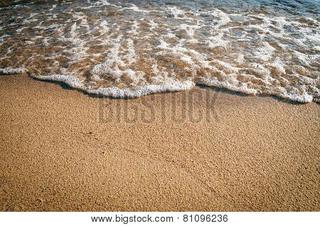 Waves on the beach with copy-space on the sand
