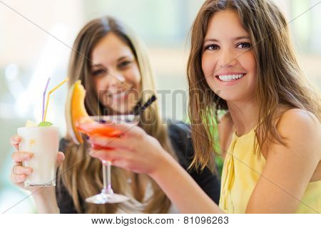 Portrait of two friends drinking a cocktail