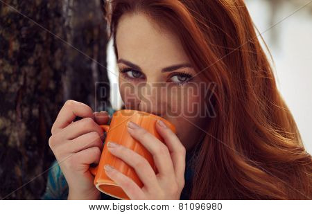 Beautiful Woman Drinking Tea Outdoor