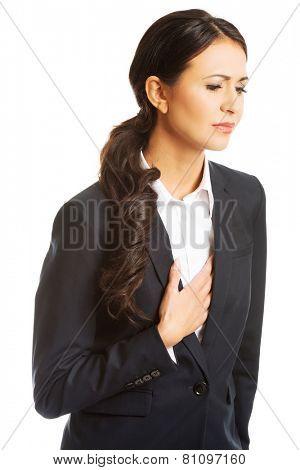 Businesswoman having strong heart disease.
