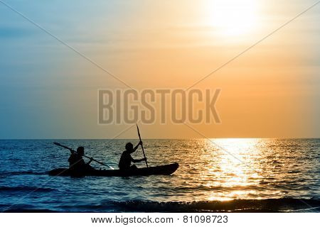 The Silhouette Of Rowing Boat