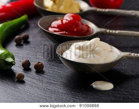 Mustard, Tomato Sauce And Mayonnaise On   Black Table.