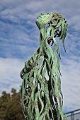 stock photo of metal sculpture  - A green metal sculpture of a lady - JPG