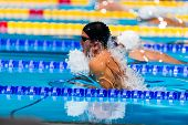 pic of olympic-games  - young breaststroke swimmer performing  in swimming race - JPG