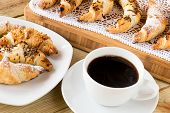 foto of croissant  - coffee cup with croissants on wooden table - JPG