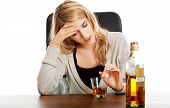 foto of alcohol abuse  - Yound beautiful woman in depression - JPG