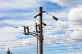 stock photo of voltage  - High voltage electricity pylon over cloudy sky - JPG