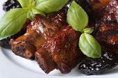 foto of stew  - Pork ribs stewed with prunes macro - JPG