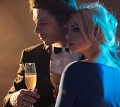 image of champagne glasses  - Attractive couple with glasses of champagne - JPG