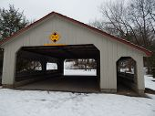 image of covered bridge  - a covered bridge sits in the snow during a cold winter - JPG