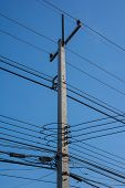 stock photo of utility pole  - Pole to the sky filled with lots of wires - JPG