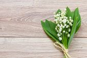 pic of lillies  - lilly of the valley flowers posy on wooden background with copy space
