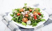 picture of masago  - Mixed salad with tuna and tomatoes on a wooden background - JPG