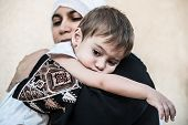 stock photo of arabic woman  - Arabic Muslim Middle Eastern woman with little son - JPG