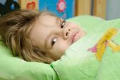 foto of 6 year old  - Six year old girl woke up in the morning in her crib - JPG