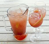 foto of pitcher  - Grapefruit lemonade pitcher with two glasses on the wooden table - JPG