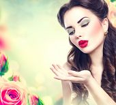 pic of blow-up  - Retro woman portrait in beauty pink roses garden - JPG