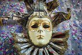 image of venetian carnival  - Classical venetian carnival mask on wood and confetti - JPG