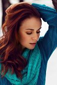 image of woman red blouse  - Sensual beautiful woman with red hair and blue blouse being sad - JPG