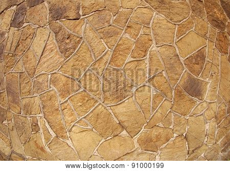 The Texture Of Brown Stone Wall