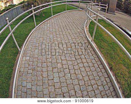 Ramp For Physically Challenged From The Granite Pavement