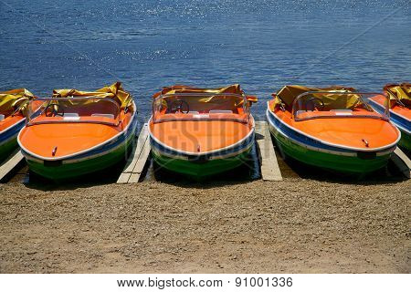 Pedal Boats Side By Side On The Shores