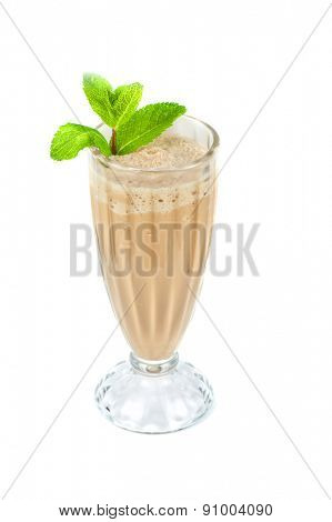 chocolate milk shake with mint leaves decorated