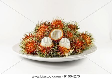 Fresh Ripe Rambutan On Dish With White Background