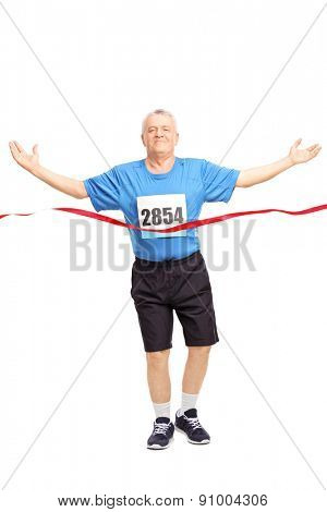 Full length portrait of a mature runner finishing a race and celebrating his victory isolated on white background