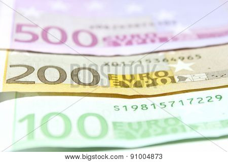 One hundred, two hundred and five hundred euro banknotes closeup. Shallow focus.