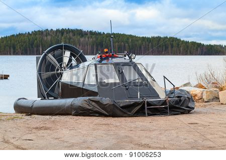 Black Modern Hovercraft Is Laying On The Coast