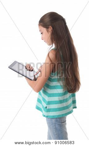 Beautiful pre-teen girl using a tablet computer.