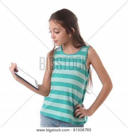 Beautiful pre-teen girl with a tablet computer