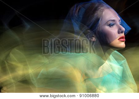 Portrait girl model in the studio, taken with mixed light