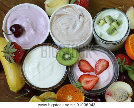 assortment of different yogurt for breakfast with berries and fruits