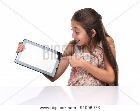 Beautiful pre-teen girl showing a tablet computer.