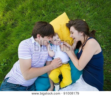 happy family on a blanket in the garden
